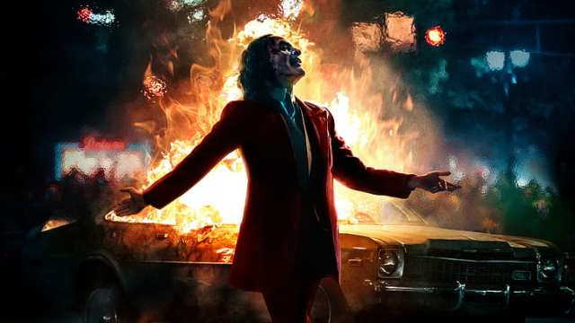 joaquin-phoenix-joker-batman-fire-car-hd-wallpaper-preview